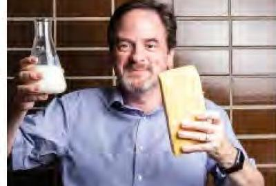 Image of a person holding milk and butter.
