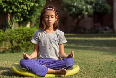 Image of young person meditating