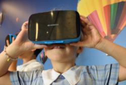 Image of young person wearing VR headset